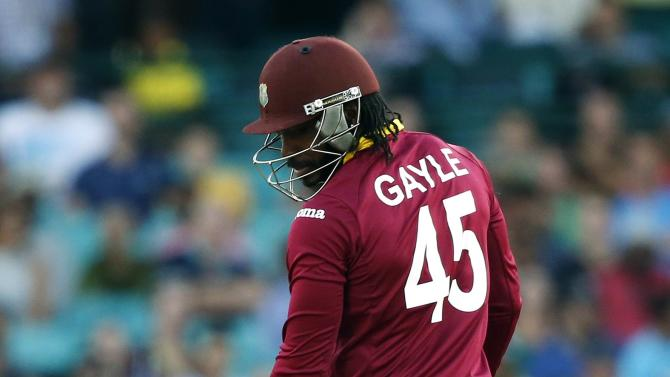 West Indies batsman Chris Gayle reacts after being bowled for three runs by South Africa's Kyle Abbott during their Cricket World Cup match at the SCG