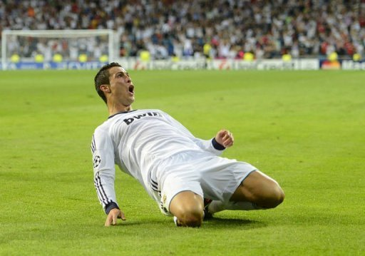 Real Madrid's forward Cristiano Ronaldo celebrates after scoring during their UEFA Champions League football match against Manchester City at the Santiago Bernabeu stadium in Madrid. Ronaldo struck a last-minute winner as Real Madrid beat Manchester City 3-2 in a thrilling Champions League clash that saw all the goals come in a nerve-wracking final 22 minutes