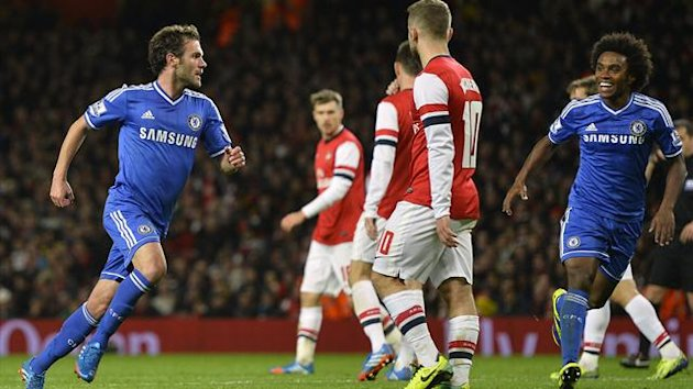 Chelsea's Juan Mata (L) celebrates scoring against Arsenal during their English League Cup