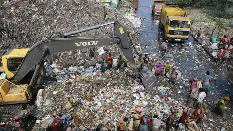 Indian ragpickers look for recyclable material at a landfill site in Gauhati, India, Wednesday, Aug. 27 2014. (AP Photo/Anupam Nath)
