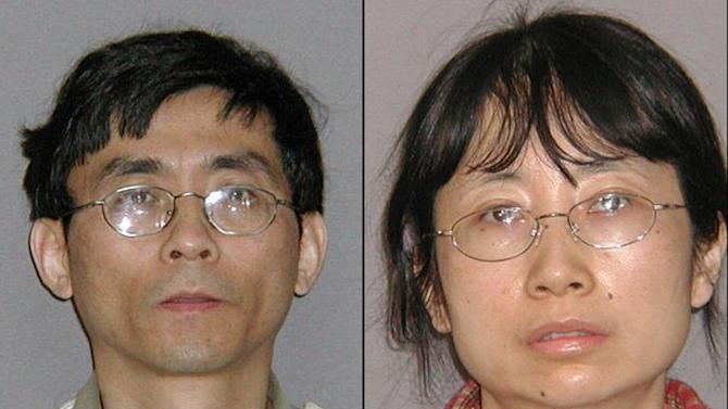 FILE - This combination of July 22, 2010 file photos provided by the U.S. Marshals Service shows Yu Qin, left, and his wife, Shanshan Du. A federal grand jury in Detroit on Friday, Nov. 30, 2012, convicted Du, a former General Motors engineer with access to the automakerís hybrid technology, along with her husband of stealing trade secrets for possible use in China. (AP Photo/U.S. Marshals Service, File)