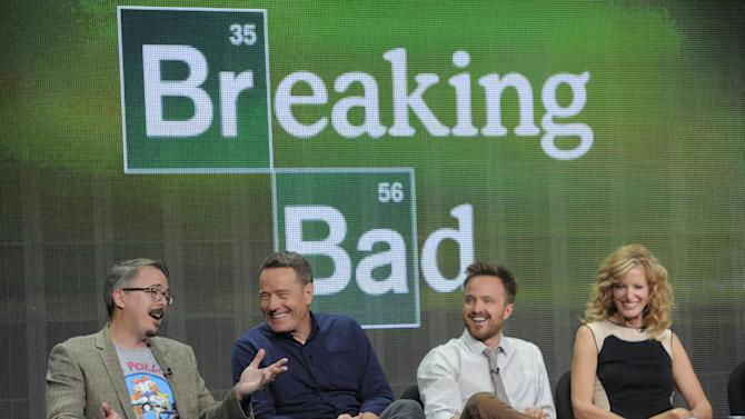 """Vince Gilligan, far left, creator and executive producer of the television series """"Breaking Bad,"""" takes part in a panel discussion with cast members, from left, Bryan Cranston, Aaron Paul and Anna Gunn during AMC's Summer 2013 TCA press tour at The Beverly Hilton Hotel on Friday, July 26, 2013, in Beverly Hills, Calif. (Photo by Chris Pizzello/Invision/AP)"""