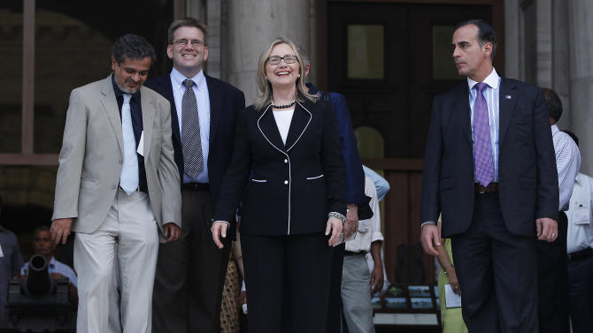 U.S. Secretary of State Hillary Rodham Clinton, center, stands on the steps of the Victoria Memorial Hall in Kolkata, India, Sunday, May 6, 2012. (AP Photo/Shannon Stapleton, Pool)