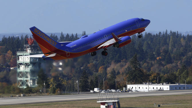 A Southwest Airlines plane takes off Monday, Oct. 28, 2013, from Seattle-Tacoma International Airport in Seattle. The modernization of the U.S. air traffic control system, one of the government's most ambitious and complex technology programs, is in trouble. The Next Generation Air Transportation System, or NextGen, was sold to Congress and the public by the Federal Aviation Administration a decade ago as a way to accommodate an anticipated surge in air travel, reduce fuel consumption and improve safety and efficiency. (AP Photo/Ted S. Warren)