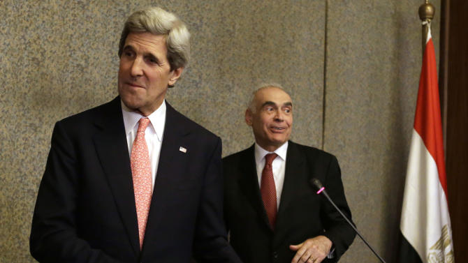 U.S. Secretary of State John Kerry, left, and Egyptian Foreign Minister Mohammed Kamel Amr leave after a news conference at the Ministry of Foreign Affairs in Cairo, Egypt on Saturday, March 2, 2013. Cairo is the sixth leg of Kerry's first official overseas trip and begins the Middle East portion of his nine-day journey. (AP Photo/Jacquelyn Martin, Pool)