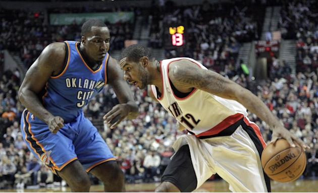 Portland Trail Blazers forward LaMarcus Aldridge, right,  drives on Oklahoma City Thunder center Kendrick Perkins during the second half of an NBA basketball game against the Oklahoma Thunder in Portl