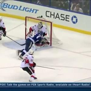 Martin St. Louis chips one past Robin Lehner