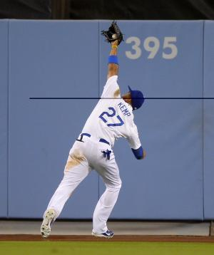 Los Angeles Dodgers center fielder Matt Kemp makes a catch on a ball hit by San Francisco Giants' Marco Scutaro to end their baseball game, Tuesday, June 25, 2013, in Los Angeles. The Dodgers beat the Giants 6-5. (AP Photo/Mark J. Terrill)