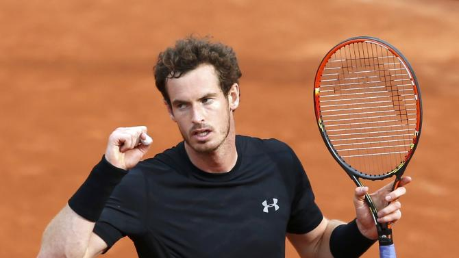 Andy Murray of Britain celebrates after beating Joao Sousa of Portugal during their men's singles match at the French Open tennis tournament at the Roland Garros stadium in Paris