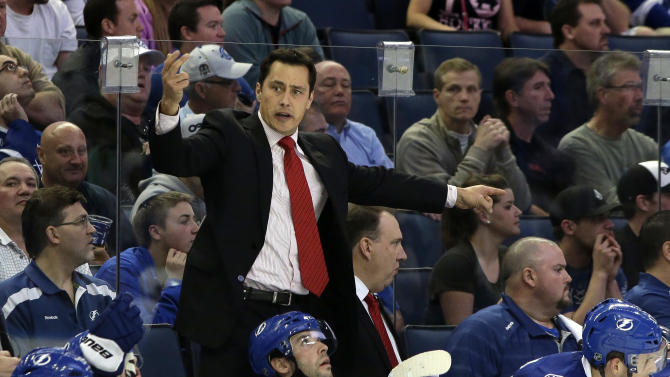 In this Tuesday, Feb. 26, 2013 photo, Tampa Bay Lightning head coach Guy Boucher pulls goalie Mathieu Garon during the third period of an NHL hockey game against the Buffalo Sabres, in Tampa, Fla. The Tampa Bay Lightning fired Boucher on Sunday, March 24, 2013. (AP Photo/Chris O'Meara)