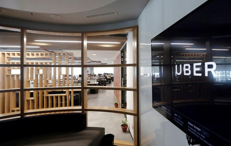 Toyota, Uber latest to join forces in ride-sharing rush