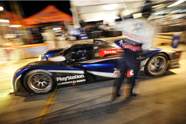 Peugeot driver Stephane Sarrazin, of France, leaves the pits after his last pit stop on his way to winning the American Le Mans Series' Petit Le Mans auto race at Road Atlanta, Saturday, Oct. 1, 2011,