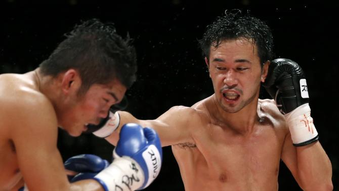 Yamanaka of Japan punches Sor Rungvisai of Thailand during their WBC bantamweight title bout in Tokyo