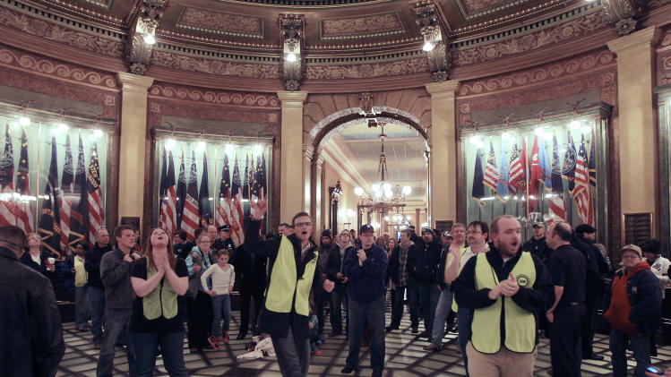 Mich. legislators defy unions, OK right-to-work