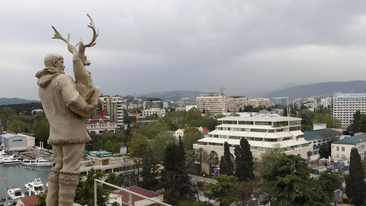 In this photo taken on Thursday, May 19, 2011, an old Soviet style statue of a reindeer breeder, left, is seen over the Black Sea resort of Sochi, southern Russia. Russia's secret service said Thursday, May 10, 2012, that it had foiled terror attack plans in the Black Sea resort of Sochi ahead of the 2014 Winter Games. The FSB said it suspects the attacks were being masterminded by Doku Umarov. The FSB also said that it suspects that Umarov has close links to the secret service in Georgia. .(AP Photo/Alexander Zemlianichenko, file)