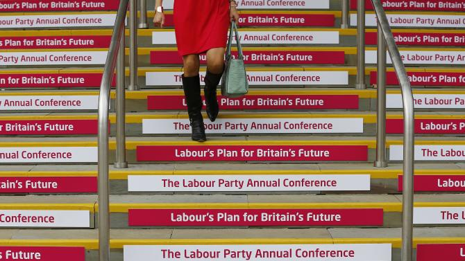 A delegate descends a flight of stairs during the Labour Party's annual conference in Manchester