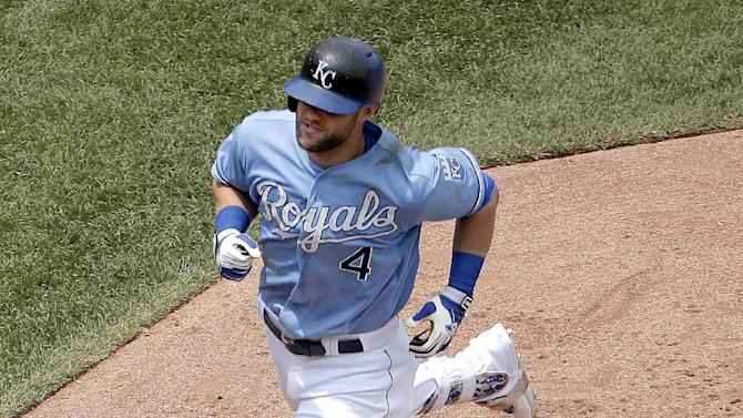 Kansas City Royals' Alex Gordon rounds the bases after hitting a solo home run during the fourth inning of the first game in a baseball doubleheader against the Tampa Bay Rays, Tuesday, July 7, 2015, in Kansas City, Mo. (AP Photo/Charlie Riedel)