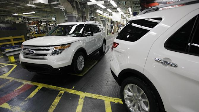 FILE - In this Dec. 1, 2010 file photo, plant employees drive 2011 Ford Explorer vehicles off the assembly line at Ford's Chicago Assembly Plant in Chicago. Federal safety regulators are investigating complaints that the power steering can fail on 2011 Ford Explorer SUVs. The problem could affect 83,000 Explorers. No crashes or injuries have been reported to the National Highway Traffic Safety Administration, which announced the probe on its website Friday, June 22, 2012. (AP Photo/M. Spencer Green, File)