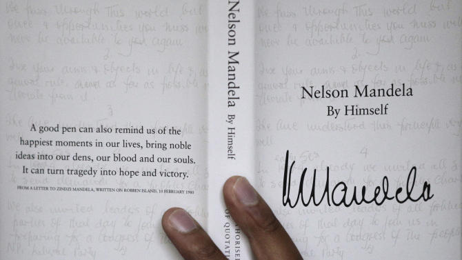 "A copy of former South African president Nelson Mandela's newly released book, titled Nelson Mandela By Himself, is held up for a photograph in Johannesburg, South Africa, Monday, June 27, 2011. A new Nelson Mandela book, slim, bound in black and set in eye-straining type, looks a bit like a bible or a prayer book. That's fitting, because the editors of ""Nelson Mandela By Himself"" brought something close to religious zeal to the task of choosing and checking more than 2,000 quotations to ensure the world gets the anti-apartheid icon's words right. (AP Photo/Themba Hadebe)"