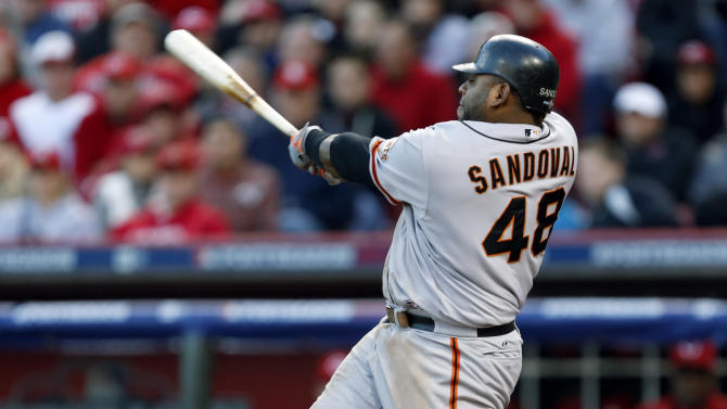 San Francisco Giants' Pablo Sandoval hits a two-run home run in the seventh inning of Game 4 of the National League division baseball series against the Cincinnati Reds, Wednesday, Oct. 10, 2012, in Cincinnati. (AP Photo/David Kohl)