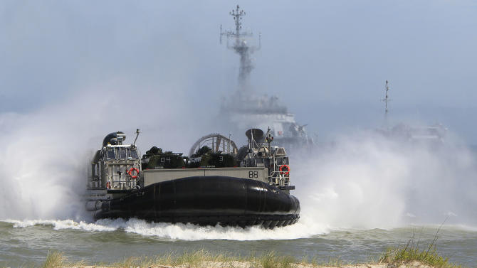 An air-cushion vehicle goes toward the beach as NATO troops participate in the NATO sea exercises BALTOPS 2015 that are to reassure the Baltic Sea region allies in the face of a resurgent Russia, in Ustka, Poland, Wednesday, June 17, 2015.(AP Photo/Czarek Sokolowski)