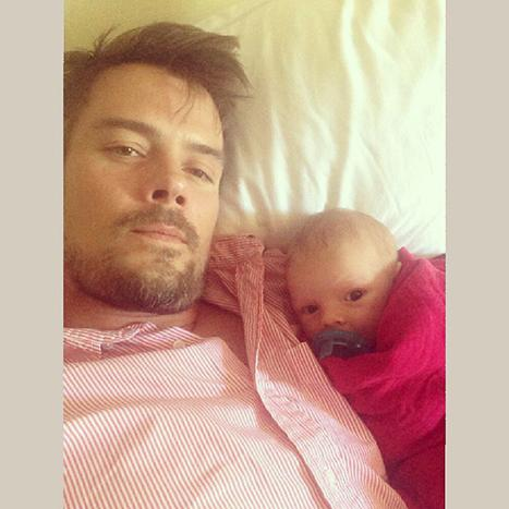 Josh Duhamel Cuddles Up to Baby Boy Axl to Watch Football: Picture