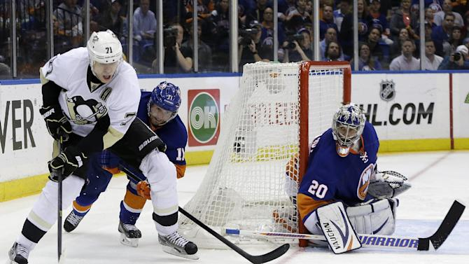 New York Islanders defenseman Lubomir Visnovsky (11), of Slovakia, and goalie Evgeni Nabokov (20) of Kazakhstan defend Pittsburgh Penguins center Evgeni Malkin (71), of Russia, in the third period of Game 6 of a first-round NHL Stanley Cup playoff hockey series in Uniondale, N.Y., Saturday, May 11, 2013. The Penguins won 4-3, advancing to the Eastern Conference semifinals. (AP Photo/Kathy Willens)