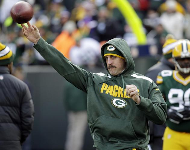 Green Bay Packers' Aaron Rodgers throws before an NFL football game against the Minnesota Vikings Sunday, Nov. 24, 2013, in Green Bay, Wis