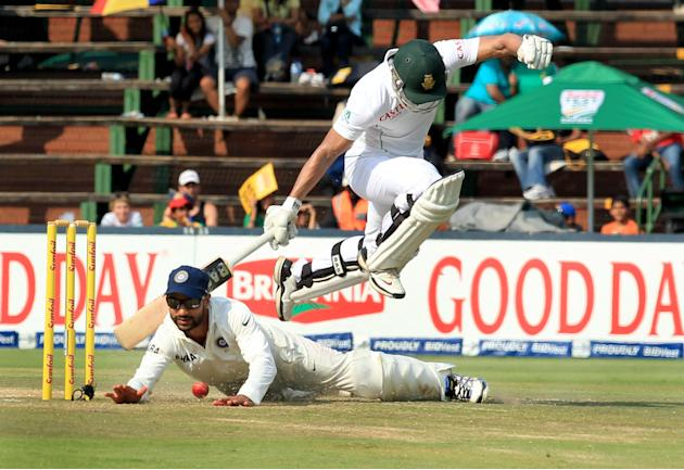 South African batsman Alviro Petersen jumps to avoid collision with Indian player Shikhar Dhawan on the fourth day of 1st Test match between India and South Africa at Wanderers in Johannesburg on 21 D