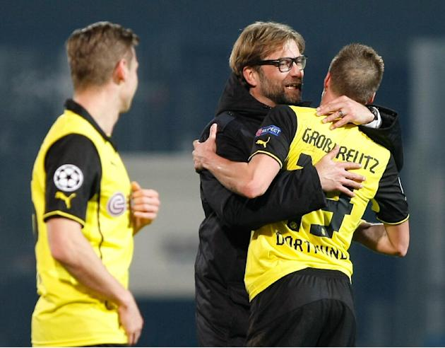 Dortmund head coach Juergen Klopp, 2nd right, congratulates his player, Kevin Grosskreutz, who scored the winning goal at the end of the Group F Champions League soccer match between Olympique Marseil