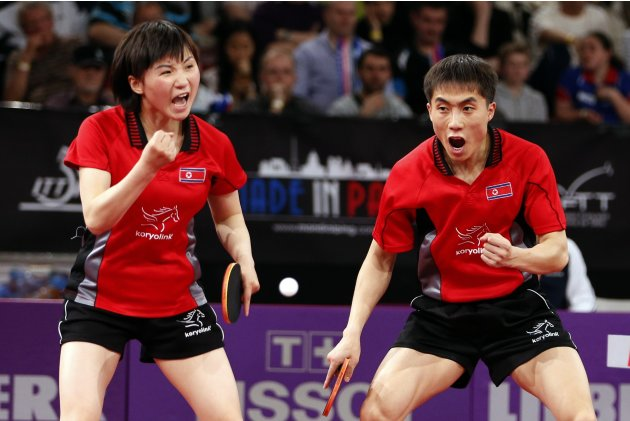 North Korea's Kim and Kim react during their mixed doubles final against South Korea at the World Team Table Tennis Championships in Paris
