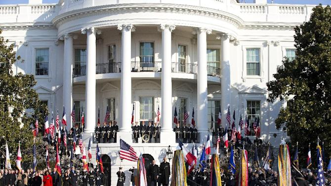 President Barack Obama and French President François Hollande stand for the national anthem during a state arrival ceremony on the South Lawn of the White House in Washington, Tuesday, Feb. 11, 2014. Overshadowed by the intrigue of a European love triangle and a glamorous White House gala, Tuesday's policy talks between President Barack Obama and French President Francois Hollande will showcase a revamped relationship that is now a cornerstone of diplomatic efforts in Iran and Syria, as well as the fight against extremism in northern Africa. (AP Photo/ J. Scott Applewhite)