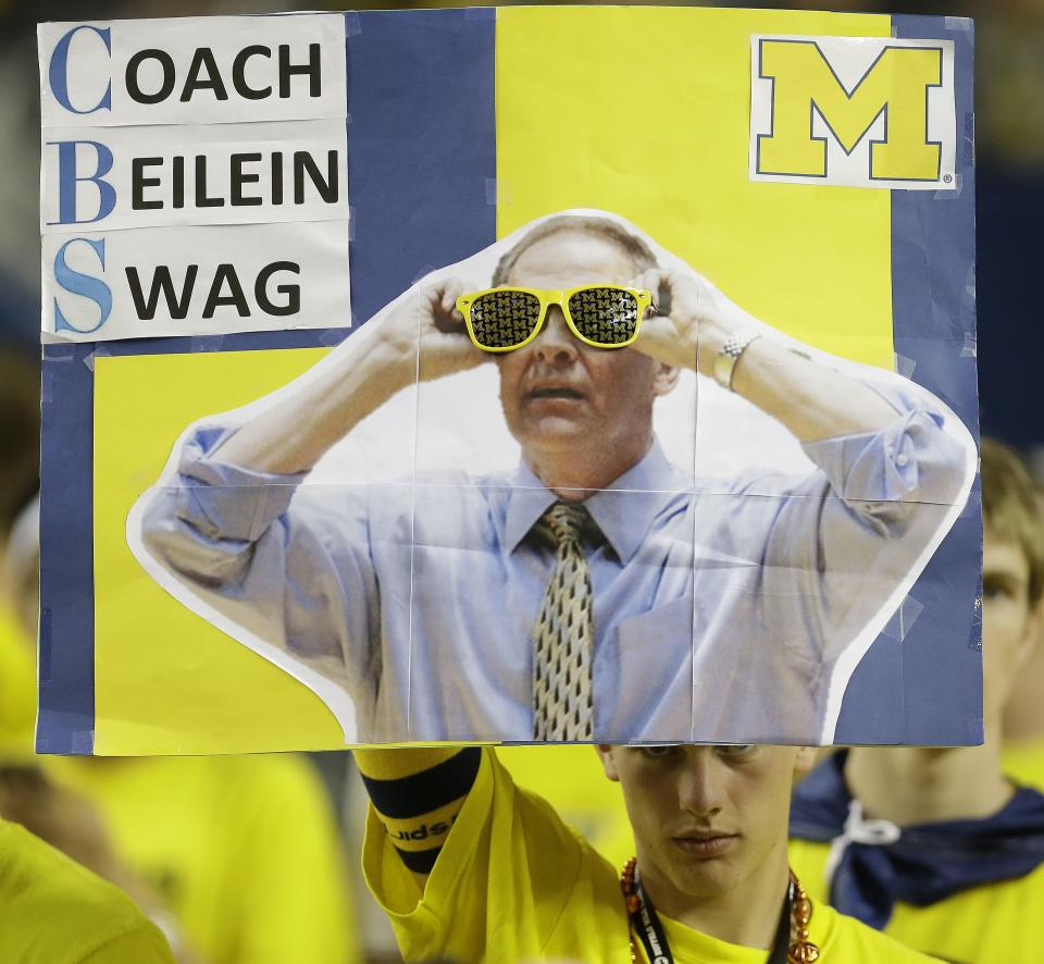 A Michigan fan holds signage showing Michigan head coach John Beilein before the first half of the NCAA Final Four tournament college basketball championship game against the Louisville, Monday, April 8, 2013, in Atlanta. (AP Photo/Charlie Neibergall)