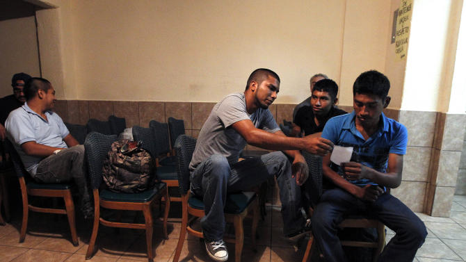 Several immigrants, many of them Mexican citizens, gather in a chapel area at a well known immigrant shelter, as many are making tough decisions on whether to try their luck at trying to make it to the United States, by illegally crossing the border, Thursday, Aug. 9, 2012, in Nogales, Mexico.  Many of them have already been caught in the United States and been shipped back to Mexico before. (AP Photo/Ross D. Franklin)
