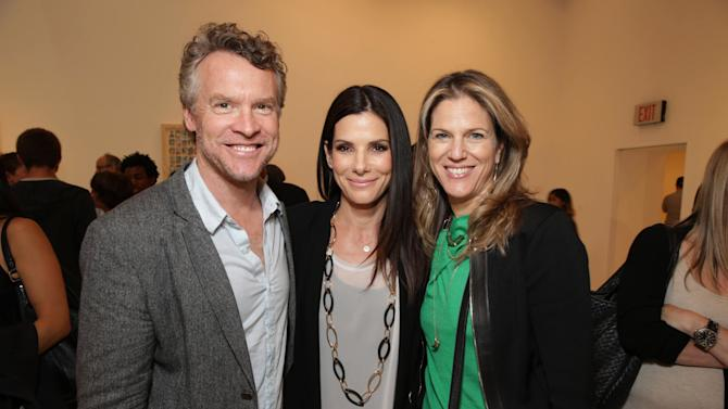 EXCLUSIVE CONTENT - PREMIUM RATES APPLY Tate Donovan, Sandra Bullock, Warner Bros.' Lynn Harris at Artist Pat Riot's Art Exhibit, 'Out of Left Field' benefiting the MLB Urban Youth Academy on Thusday, May, 23rd, 2013 in Los Angeles. (Photo by Eric Charbonneau/Invision for Protagonist Brand Management/AP Images)