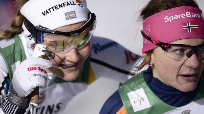 Sweden's Nilsson and Norway's Falla compete during their women's 1.4 km Sprint Classic finals at the FIS Ruka Nordic 2015 in Kuusamo