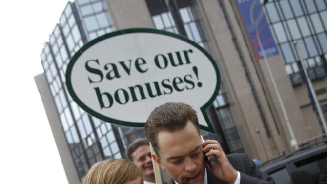 File - In this Sept. 7, 2010 file photo, members of Oxfam are dressed as bankers during a demonstration outside of a meeting of EU finance ministers at the EU Council building in Brussels. Top European Union officials late Wednesday, Feb. 27, 2013 struck an agreement on a package of financial laws that includes capping bankers' bonus payments at a maximum of one year's base salary. The bonuses will only be allowed to reach twice the annual fixed salary if a large majority of a bank's shareholders agrees. (AP Photo/Virginia Mayo, File)