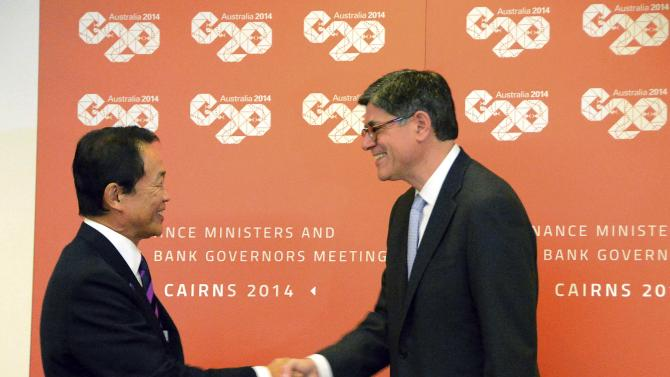 Japan's Finance Minister Taro Aso and U.S. Treasury Secretary Jack Lew shake hands before the start of their bilateral meeting ahead of the G20 Finance Ministers and Central Bank Governors meeting in Cairns