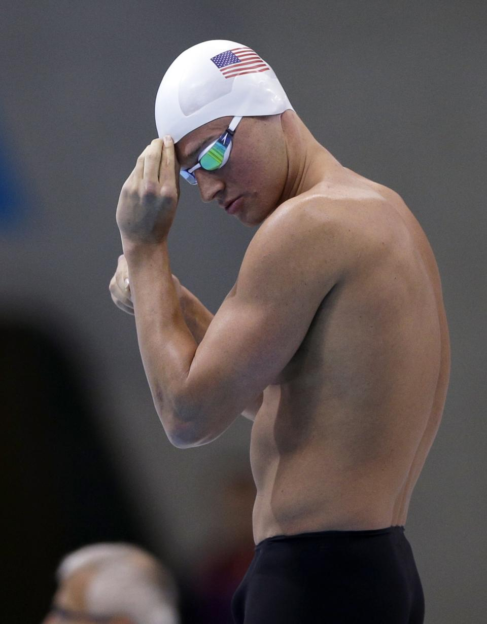 United States' gold medalist Ryan Lochte prepares to compete in the men's 200-meter freestyle swimming heat at the Aquatics Centre in the Olympic Park during the 2012 Summer Olympics in London, Sunday, July 29, 2012. (AP Photo/Matt Slocum)