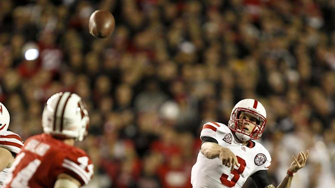 Nebraska quarterback Taylor Martinez (3) throws a pass as Wisconsin's Chris Borland (44) defends during the first half of an NCAA college football game Saturday, Oct. 1, 2011, in Madison, Wis. (AP Photo/Andy Manis)