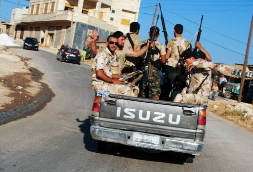 Image from the Syrian opposition's Shaam News Network July 5, shows members of the Free Syrian Army in Sarmada, Idlib province. The US is set to call for tough new UN sanctions against President Bashar al-Assad and his inner circle.
