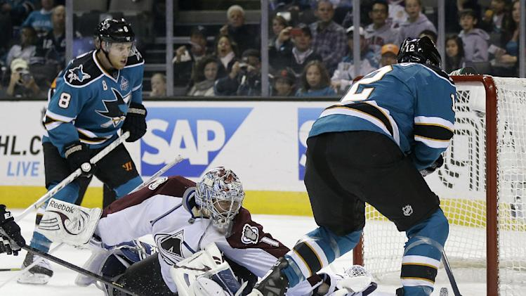 San Jose Sharks center Patrick Marleau, right, scores past Colorado Avalanche goalie Semyon Varlamov, center, of Russia, for his second goal of the first period of an NHL hockey game in San Jose, Calif., Saturday, Jan. 26, 2013. (AP Photo/Marcio Jose Sanchez)
