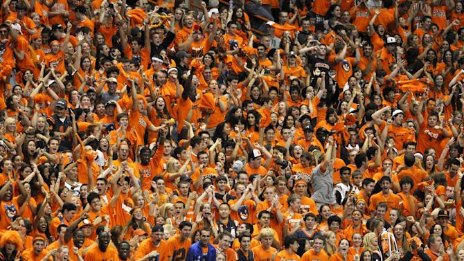 FILE - In this Sept. 18, 2010, file photo, the Syracuse student section erupts during an NCAA college football game against Maine in Syracuse, N.Y. The Princeton Review's annual rankings of campus life issue, released Monday, Aug. 4, 2014, put the Orange at No. 1 on the list of the nation's top party schools. (AP Photo/Kevin Rivoli, File)