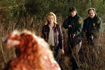 Elizabeth Banks , Nathan Fillion and Don Thompson (II) in Universal Pictures' Slither