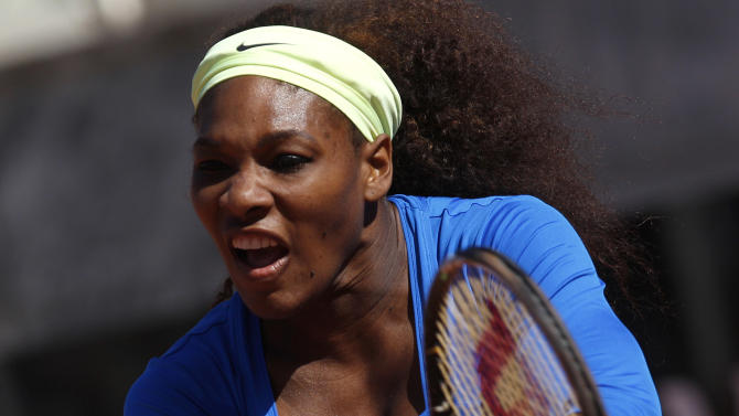Serena Williams of the United States returns the ball to Anabel Medina Garrigues of Spain during their match at the Italian Open tennis tournament, in Rome, Thursday,  May 17, 2012. Serena Williams beat Anabel Medina Garrigues 6-3, 6-1. (AP Photo/Alessandra Tarantino)