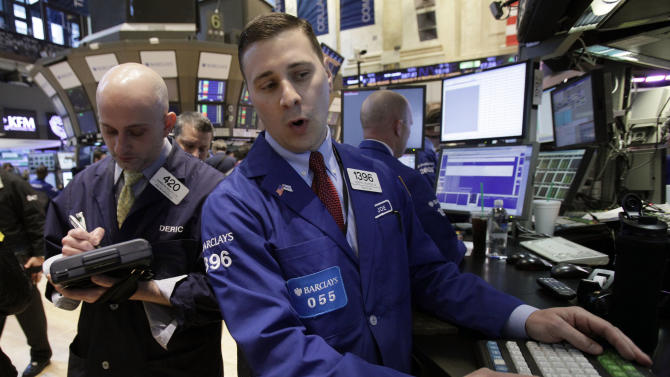In an April 16, 2012 photo trader Damian Bagarozza left, and specialist Joseph Mastrolia work on the floor of the New York Stock Exchange.    Wall Street was headed for a higher open Tuesday April 24, 2012, with Dow Jones industrial futures gaining 0.2 percent and S&P 500 futures up 0.3.  (AP Photo/Richard Drew)