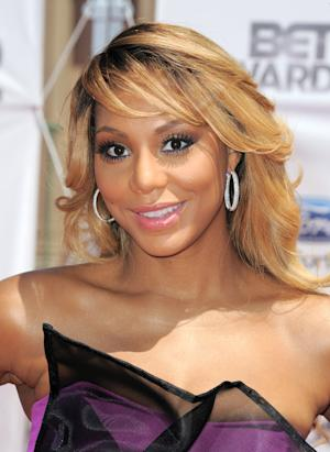 "FILE - This July 1, 2012 file photo shows Tamar Braxton at the BET Awards in Los Angeles. Braxton debuted at No. 13 and No. 5 with ""Love & War"" on Billboard's R&B/Hip-Hop songs and R&B songs charts, respectively. The 35-year-old has been buzzing since a reality show starring her and her sisters premiered on WEtv last year. Her spotlight grew brighter when a spin-off with her husband Vincent Herbert _ who manages Lady Gaga _ kicked off this year. (Photo by Jordan Strauss/Invision/AP, file)"