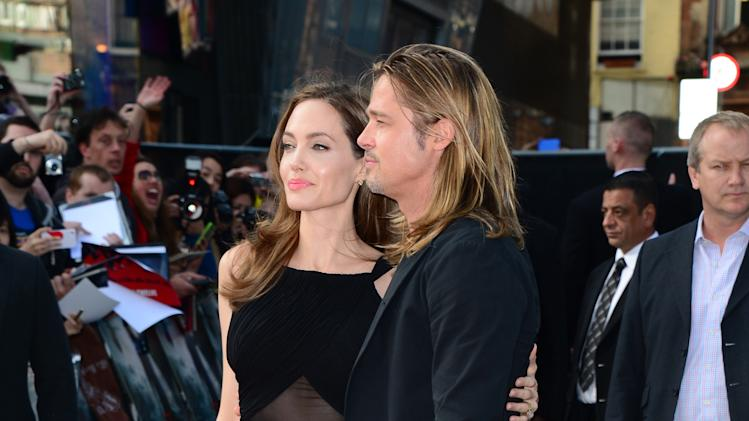 Angelina Jolie and Brad Pitt arrive at the World Premiere of 'World War Z' at the Empire Cinema in London, Sunday June 2nd, 2013. (Photo by Jon Furniss/Invision/AP Images)