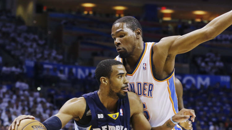 Memphis Grizzlies point guard Mike Conley (11) drives around Oklahoma City Thunder small forward Kevin Durant (35) during the first half at Game 2 of their Western Conference semifinal NBA basketball playoff series Tuesday, May 7, 2013, in Oklahoma City. (AP Photo/Tony Gutierrez)