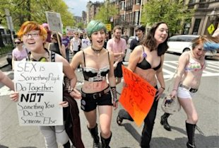 From left, Isa Stearns of Somerville, Mass., Nadia Friedler of Cambridge, Mass., Louisa Carpenter-Winch, of Cambridge, Mass., and Emma Munson-Blatt, of Cambridge, Mass, chant during the